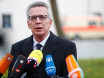 German Interior Minister de Maiziere gives an statement in Wittenberg
