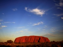 FILE PHOTO: Uluru is lit by the setting sun in the Northern Territory in central Australia