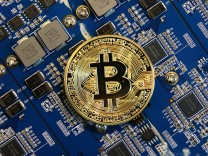 ST PETERSBURG RUSSIA SEPTEMBER 26 2017 A Bitcoin cryptocurrency souvenir coin Alexander Demian