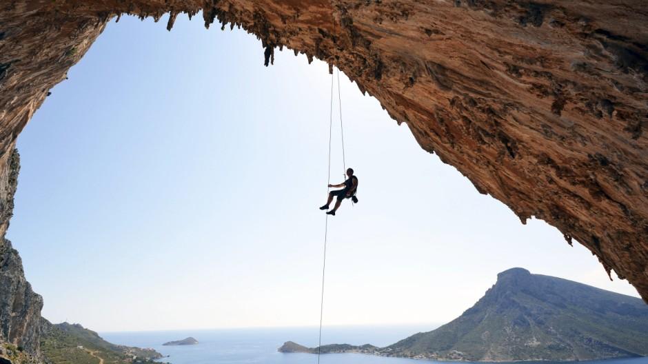 Greece Kalymnos climber abseiling in grotto model released Symbolfoto PUBLICATIONxINxGERxSUIxAUTxH