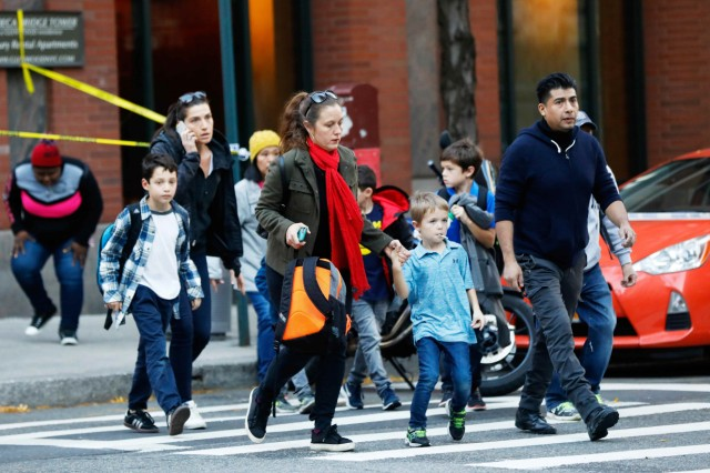 Parents pick up their children from P.S./I.S.-89 school after a shooting incident in New York City