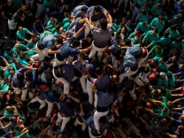 The group Colla els Capgrossos de Mataro form a human tower called 'Castell' during the All Saints Day in Vilafranca del Penedes