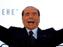 Forza Italia party leader Silvio Berlusconi gestures as he speaks during a rally in Catania