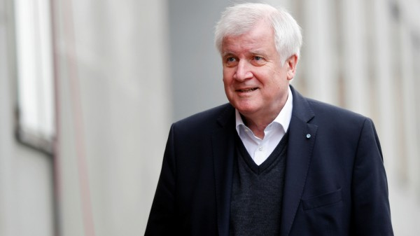 CSU leader Seehofer arrives at the German Parliamentary Society offices before the start of exploratory talks about forming a new coalition government in Berlin