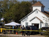 Law enforcement officials investigate a mass shooting at the First Baptist Church in Sutherland Springs