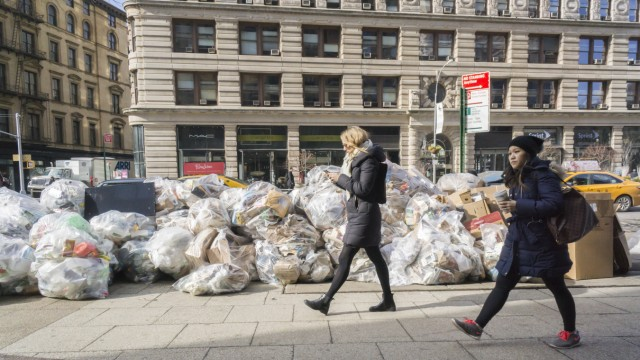 Trash accumulates and awaits pick up in New York Bags of trash await pick up in the Flatiron neighbo
