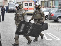 German special police arrive at the scene during a hostage taking at a district office in Pfaffenhofen