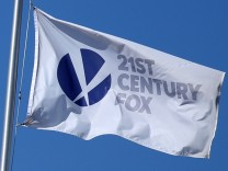 FILE PHOTO: The Twenty-First Century Fox Studios flag flies over the company building in Los Angeles