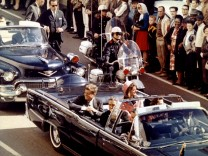 FILE PHOTO: U.S. President John F. Kennedy, First Lady Jaqueline Kennedy and Texas Governor John Connally ride  in a liousine moments before Kennedy was assassinated, in Dallas