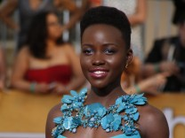 File photo of Lupita Nyong'o arriving at the 20th annual Screen Actors Guild Awards in Los Angeles; luoita+jetzt