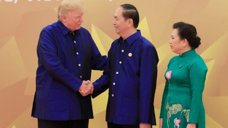 U.S. President Donald Trump is welcomed by his Vietnamese counterpart Tran Dai Quang and his wife Nguyen Thi Hien for the gala dinner of the Asia-Pacific Economic Cooperation Summit in Danang