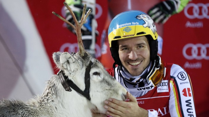 Felix Neureuther GER poses with a reindeer at the prize giving ceremony after Alpine Skiing FIS Wo