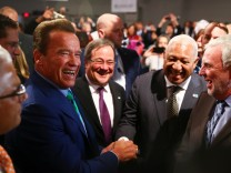 Former California governor and 'Mr. Universe' Arnold Schwarzenegger and COP 23 President Prime Minister Frank Bainimarama of Fiji shake hands during the COP23 UN Climate Change Conference 2017, hosted by Fiji but held in Bonn