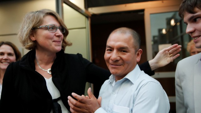 Peruvian farmer and mountain guide Saul Luciano Lliuya, his lawyer Roda Verheyen and his translator react after a high regional German court ruled against RWE, one of Europe's biggest electricity companies, in Hamm