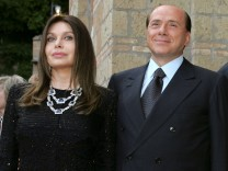 FILE PHOTO: Italy's Prime Minister Silvio Berlusconi and his wife Veronica Lario pose at Villa Madama in Rome