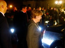 German Chancellor Merkel of the Christian Democratic Union leaves the German Parliamentary Society in Berlin