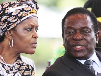 FILE PHOTO: President Robert Mugabe's wife Grace Mubage and vice-President Emmerson Mnangagwa attend a gathering of the ZANU-PF party's top decision making body, the Politburo, in the capital Harare