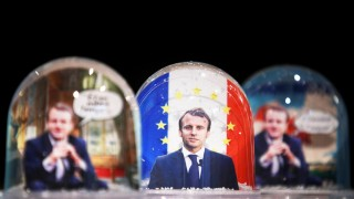 Snowglobes depicting French President Emmanuel Macron are displayed at a store in Paris