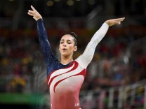 FILE PHOTO: Alexandra Raisman of USA competes on the beam during the women's team final in Artistic Gymnastics at the 2016 Rio Olympics in Rio de Janeiro