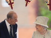 FILE PHOTO: Britain's Queen Elizabeth and Prince Philip visit Pangbourne College near Reading