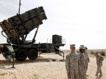 U.S. soldiers stand beside a U.S. Patriot missile system at a Turkish military base in Gaziantep, southeastern Turkey