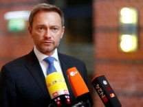 Free Democratic Party (FDP) leader Christian Lindner gives a statement as he arrives for the board meeting at the party headquarters in Berlin