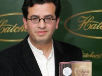 Man Booker Prize nominee Matar holds book ahead of announcement of British literary award winner in London