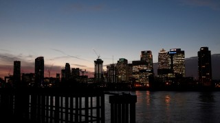The Canary Wharf financial district is seen at dusk in London