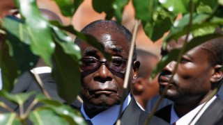 FILE PHOTO -  File photo of Zimbabwe's President Robert Mugabe arriving for the burial of ZANU (PF) member Edson Ncube in Harare