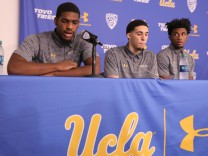 UCLA basketball players Cody Riley, LiAngelo Ball, and Jalen Hill speak at a press conference at UCLA after flying back from China where they were detained on suspicion of shoplifting, in Los Angeles