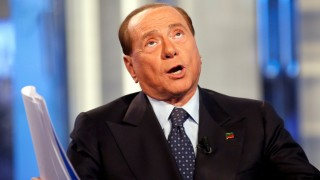 FILE PHOTO: Italy's former Prime Minister Silvio Berlusconi gestures as he attends television talk show 'Porta a Porta' (Door to Door) in Rome