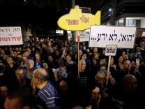 Israelis take part in a protest against corruption in Tel Aviv