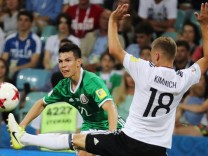 SOCHI RUSSIA JUNE 29 2017 Mexico s Hirving Lozano L and Germany s Joshua Kimmich fight for th