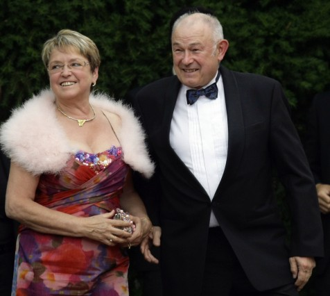 Guenther Beckstein and his wife Marga arrive for the opening of the Bayreuth Wagner opera festival