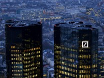 FILE PHOTO: The headquarters of Germany's Deutsche Bank is seen early evening in Frankfurt