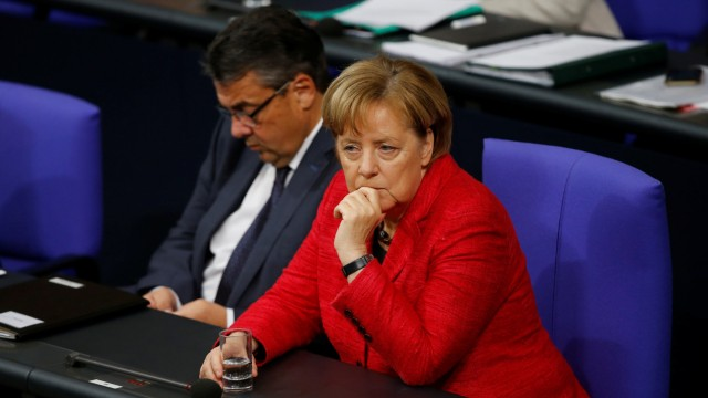 German Foreign Minister Sigmar Gabriel and Chancellor Angela Merkel are seen during a session of the Bundestag in Berlin