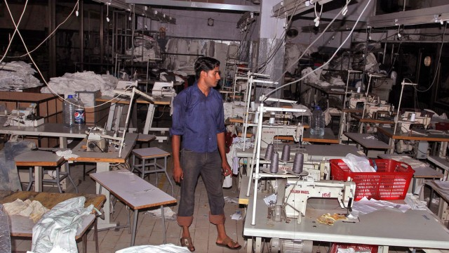 Aftermath of a fire that killed 289 people at a garment factory i