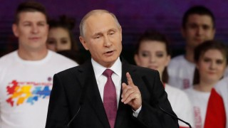 Russian President Putin addresses the audience at the congress of volunteers in Moscow