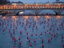 Participants start in the 8th Edition of the Nautic SUP Paris Crossing stand up paddle competition on the river Seine in Paris
