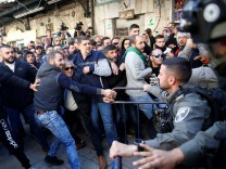 Israeli border policemen and Palestinians scuffle after Friday prayers in Jerusalem's Old City