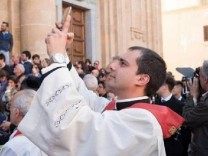 Italy: Alessandro Palermo, new catholic priest of Marsala, Sicily - here pictured - has invited the faithful to bring their smartphones into the church to bless them on the occasion of the feast of Saint Lucia, holy protector of the eyes