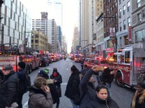 Police and fire crews block off the streets near the New York Port Authority in New York City after reports of an explosion
