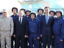 Russian President Putin, Defence Minister Shoigu and Syrian President Bashar al-Assad visit the Hmeymim air base in Latakia Province