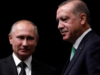 Turkish President Tayyip Erdogan poses with Russian President Vladimir Putin after a news conference in Ankara