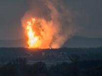 A column of fire is seen after an explosion ripped through Austria's main gas pipeline hub in Baumgarten