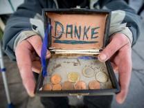 Mann bittet um Geldspende