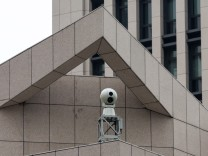 A surveillance camera is seen on the Chinese People's Liberation Army Forces building in Hong Kong