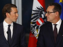 Head of the OeVP Kurz and head of the FPOe Strache address a news conference in Vienna