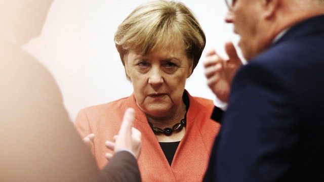 German Chancellor Merkel looks on at a CDU/CSU parliamentary group meeting at the Bundestag in Berlin