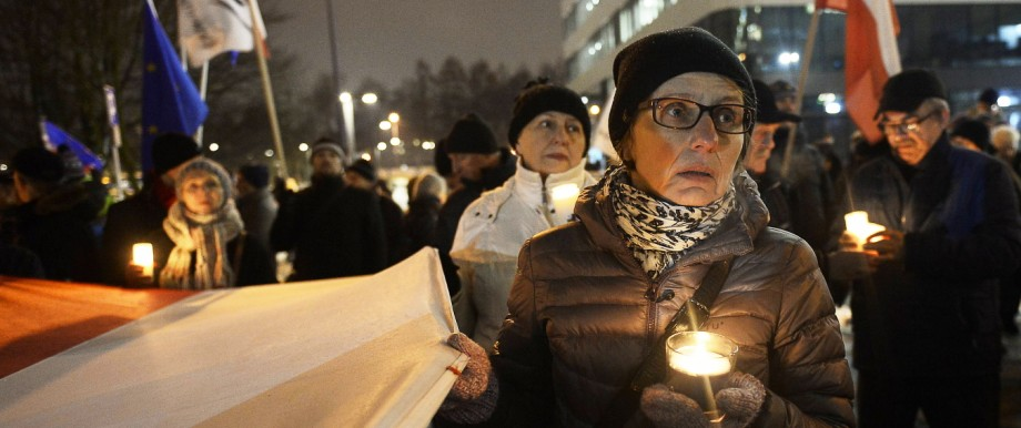 December 4 2017 Krakow Malopolska Poland A woman holds a candle during a protest against judi